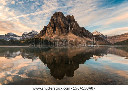 Rocky mountain reflection on Cerulean lake in Assiniboine provincial park, Canada #1584150487