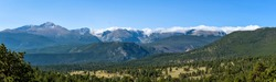 Rocky Mountains - A panoramic view of northern Front Range mountains, leading by Longs Peak at left, on a late Summer morning. Rocky Mountain National Park, Colorado, USA.