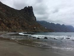 Rocky Mountains, Atlantic Ocean and coastline of Tenerife North in the cloudy day. Roque de las Bodegas village, Tenerife North, Canary Islands, Spain.