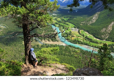 Rocky Mountains. Banff National Park. Tourist looking at Bow river valley (Alberta. Canada)