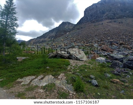 Rocky mountainside cloudy #1157106187