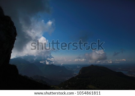 Rocky ridges of mountains view of Lecco, lake Como, clouds over #1054861811