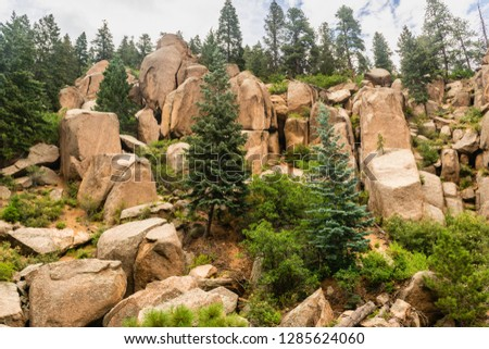 Rocky scenery seen from Pikes Peak Railway in Pike National Forest, Colorado #1285624060