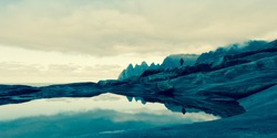 rocky sea coast at viewpoint at Devils teeth, Tungeneset, Senja