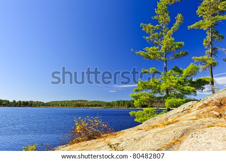 Rocky shore in wilderness of Lake of Two Rivers, Algonquin Park, Ontario, Canada