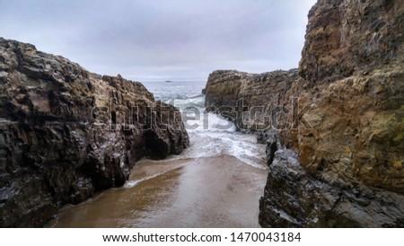 Rocky shoreline along California's coast. Rock eroded by waves