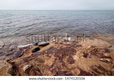 Rocky Shoreline Along Upper Michigan Beach