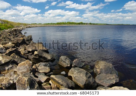 Rocky Shoreline:  Large boulders help to form a side of Petenwell Lake in central Wisconsin.
