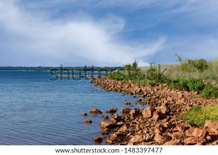 Rocky shoreline of a lake.