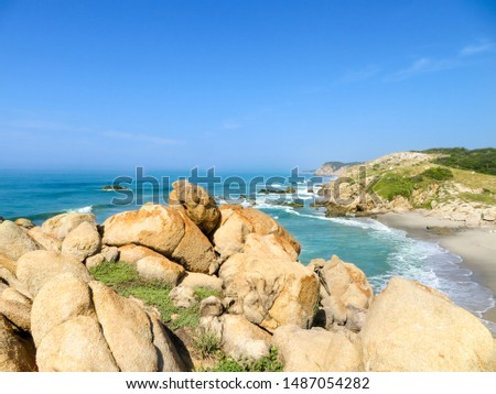 Rocky Shoreline of Oaxaca with blue skies and clear waters