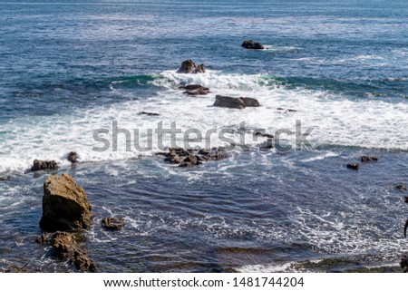 Rocky shoreline overlooking the blue ocean