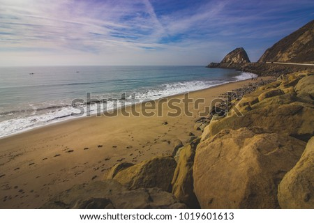 Rocky shoreline view of the Point Mugu Rock along Pacific Coast Highway, Point Mugu, California - Shutterstock ID 1019601613