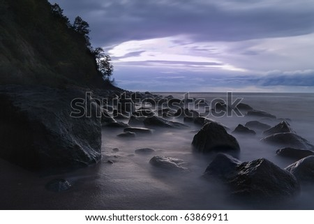 Rocky shores of the Baltic Sea at night with long exposure