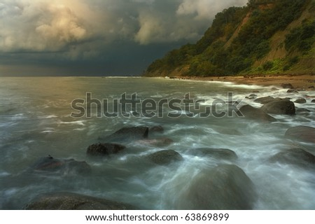 Rocky shores of the Baltic Sea with a long exposure in anticipation of the impending storm