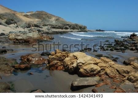 Rocky shores on the beach Chicama in La Libertad-PERU #1424341493