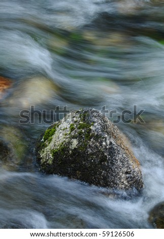 Rocky stream captured with blurred motion - stock photo