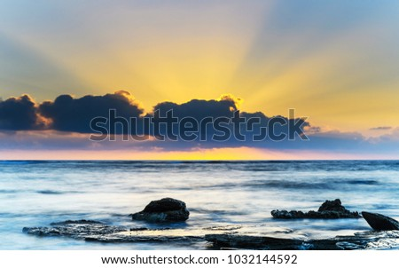 Rocky Sunrise Seascape with Sun Rays - Capturing the sunrise from Toowoon Bay Beach on the Central Coast, NSW, Australia. #1032144592