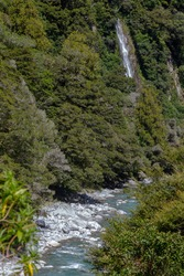 Rocky terrain and a waterfall at Thunder Creek in New Zealand