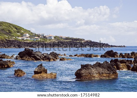 Rocky volcanic shallow coastline, Pico island, Azores, Portugal