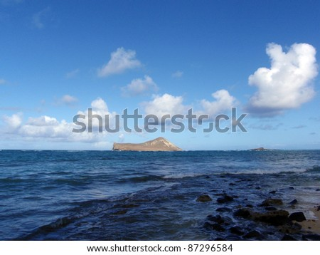 Rocky Waimanalo Beach on Oahu, Hawaii. With  rabbit and rock island seen in the distance