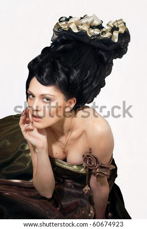Rococo style girl sitting isolated over white background