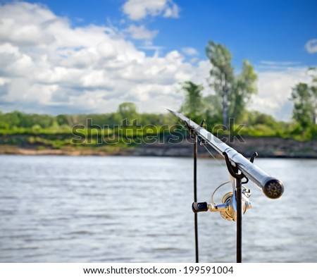 Rod lying on racks on the background of the river #199591004