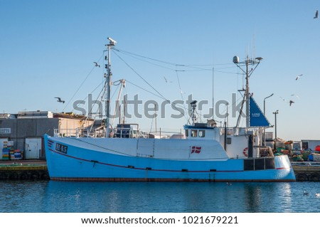 Roedvig Denmark - December 4. 2017: Blue fishing boat in port on a sunny day #1021679221