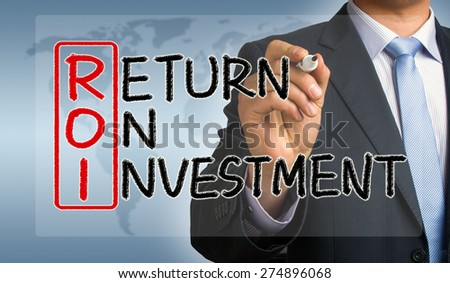 ROI concept: return on investment handwritten by businessman