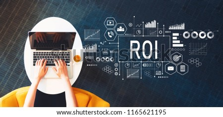 ROI with person using a laptop on a white table #1165621195