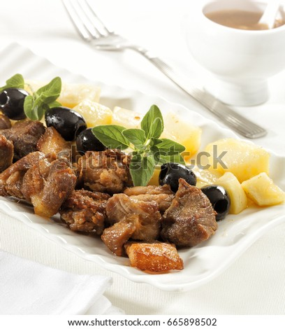 Shutterstock Rojoes a moda do Minho, typical Portuguese pork dish.