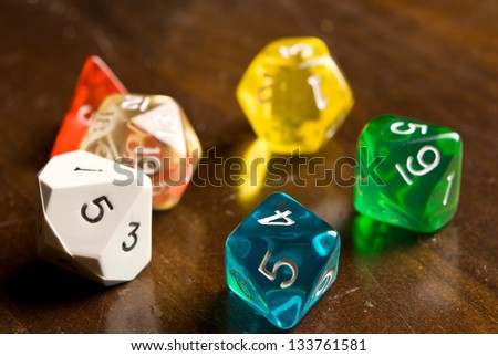 Role Play Dice on wooden table top