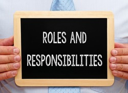 Roles and Responsibilities - Businessman holding chalkboard with text