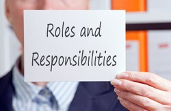 Roles and Responsibilities - Businesswoman with sign in the office