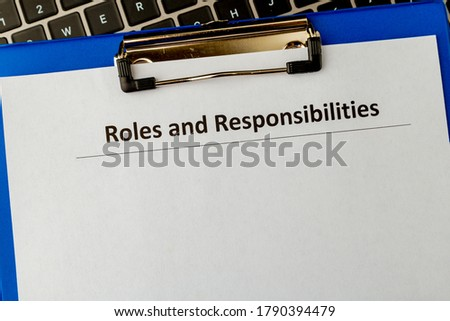 Photo of  Roles and responsibilities document in the tablet at the laptop on the table.
