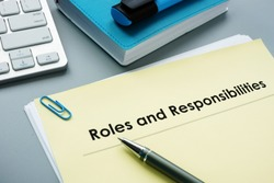 Roles And Responsibilities documents in the office.