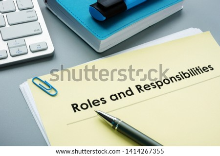 Photo of  Roles And Responsibilities documents in the office.