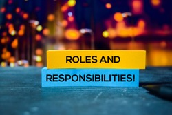 Roles and Responsibilities! on the sticky notes with bokeh background