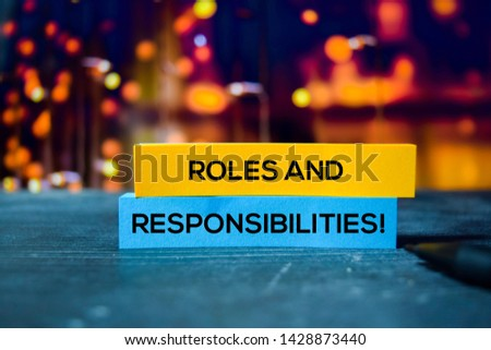 Photo of  Roles and Responsibilities! on the sticky notes with bokeh background