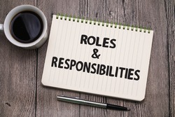 Roles and Responsibilities, text words typography written on book against wooden background, life and business motivational inspirational concept