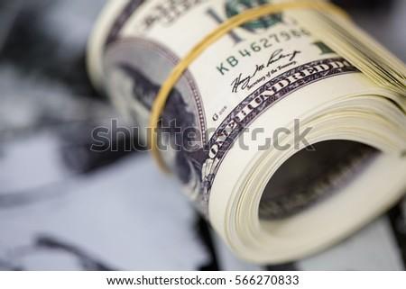 Roll a hundred dollar bill. American money banknote  #566270833