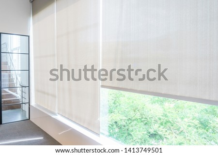 Roll Blinds on the windows, the sun does not penetrate the house. Window in the Interior Roller Blinds. Beautiful Blinds on the Window #1413749501