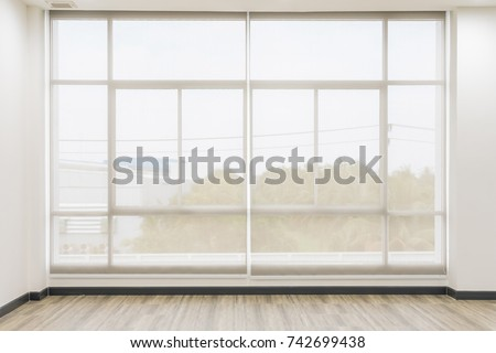 Roll Blinds on the windows, the sun does not penetrate the house. Window in the Interior Roller Blinds. Beautiful Blinds on the Window, the Sun and Heat Protection, the Perfect Windows Interior Decor #742699438
