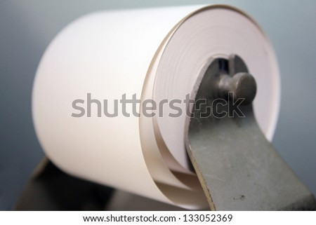 roll of adding machine tape coming unwound