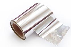 Roll of aluminium foil on white background
