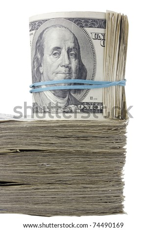 Roll of American money on a stack of cash.