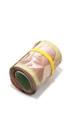 Roll of bank notes with yellow plastic band over the eyes