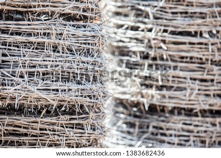 Roll of barbed wire, Bales of metal stehes, Roll barbed wire background.  #1383682436