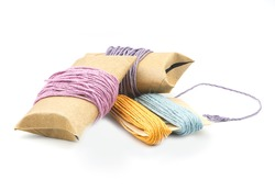 roll of colorful hemp thread on white background