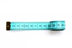 Roll of cyan measuring tape with golden metal end put geometrically on white background, isolated, top view