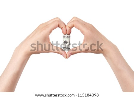 Roll of dollars with the heart  made of two women hands. love money concept